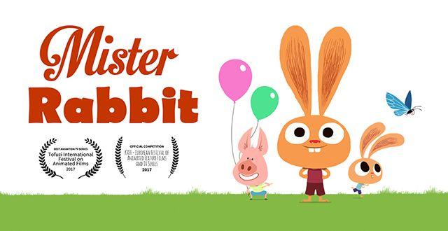 Cartoon rabbits on green grass